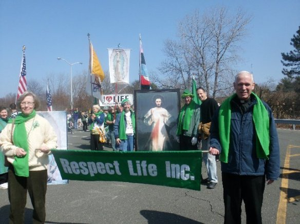 "Liz O'Brien of Rockland Right to Life Committee and Fr. Jim McKenna of the Marian Shrine lead the ""Respect Life"" group in the St. Patrick's Day Parade 2011."