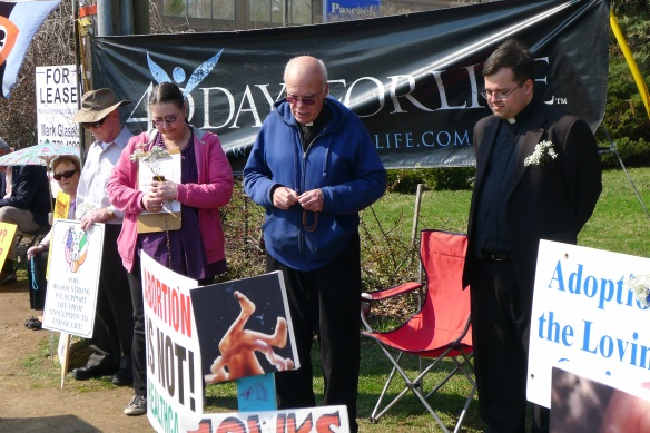 Eileen Peterson, Msgr. Michael McCabe, pastor of St. Mary of the Assumption in Haverstraw, and Fr. Nicholas Callahan lead the recitation of the Sorrowful Mysteries of the Rosary at the 40 Days for Life closing ceremony.