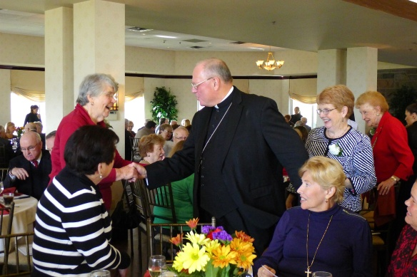 Timothy Cardina Dolan, Archbishop of New York, greets Ann O'Connor, one of the orignal Birthright volunteers.