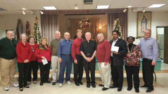At the Triune Council Christmas Party (L to R) Chet Nawoichyk (the Fisher Foundation), Liz O'Brien (Rockland RTL), Peg Beirne (Rockland Catholic Coalition), Ellen Traina (Birthright), Pete Noonan (COPS Barn), Di Felice (Financial Secretary), Kevin McGovern (COPS Barn), Msg. John J. O'Keefe (pastor of St. Margaret's) John Rio (Grand Knight), Joe Jacobs (Divine Providence), Nannette Morris (Good Counsel) and Bill Palino (Rockland Sister Cities Project)