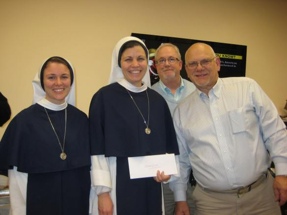 Grand Knight Stephen  Duschaneck and PGK Arthur Saladino present a Christmas donation to the Sisters of LIfe on behalf of the McCloskey Council  Photo courtesy of McCloskey Council 4565.