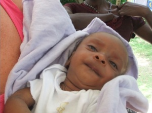 When this baby came to the clinic, she was 4 months old and weighed only 7 pounds.  She was severely malnourished.  We put her on our Medica Mamba program, giving the mom packets of fortified peanut butter and follow-up every week with a Haitian doctor who helps us out.