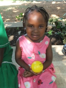 And here she is, a healthy 3 ½ year old, playing with the ball we gave her and SMILING!