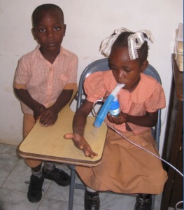 Asthma is another problem we see quite often in the clinic.  Also notice that these children are in their school uniforms.  There are many small schools in the area, and each school has a distinctive uniform.  Children often come to the clinic in their uniforms because it is the best clothing they own.